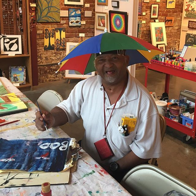 Who needs an umbrella when you have this! #Dennisthehatman #hartgallerytn #hartcha #havingfunonarainyday